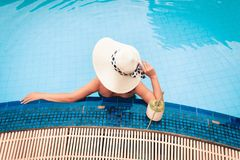 Summer concept, Asian woman relaxing in swimming pool Stock Photography