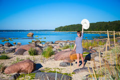 Summer concept - beautiful woman walking on the beach with picni Royalty Free Stock Photos