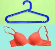 Summer concept, bra and cloth hanger. Royalty Free Stock Photography