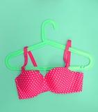 Summer concept, bra on coat hanger on blue. (Pop art style) Stock Photos