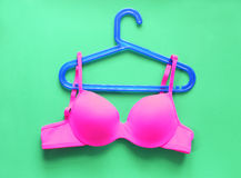 Summer concept, bra on coat hanger on green. (Pop art style) Stock Photos