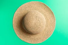 Summer concept. Braided hat on Mint background stock images