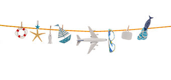 Summer concept with different utensils for traveling hanging on Stock Photo