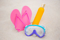 Summer concept - diving mask, slippers and suntan lotion bottle Royalty Free Stock Photo