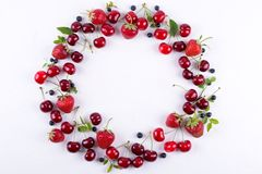 Flat lay, top view, copy space. Frame made of fresh berries. Strawberry, blueberry and sweet cherry stock images
