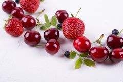 Summer concept. of fresh berries. Strawberry, blueberry and  cherry. Summer concept. of fresh berries. Strawberry, blueberry and sweet cherry Royalty Free Stock Images