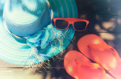 Summer Concept. Hat, Glasses and Flip Flops. Summer accessories on a wooden background. faded effect Royalty Free Stock Photography
