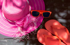 Summer Concept. Hat, Glasses and Flip Flops. Summer accessories on a wooden background. faded effect Stock Image
