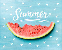 Summer concept illustration. Slice of watermelon on turquoise blue background, top view. White lettering inscription stock photo