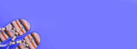 Summer concept. image of beach flip-flops on the lilac backgroun. Image of beach flip-flops on a lilac background with copy space. summer concept stock images