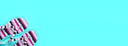 Summer concept. Red beach flip flop on turquoise background wi. Red beach flip flop on turquoise background. summer concept royalty free stock image