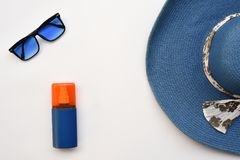 Summer concept. Relax on the beach. Sunblock, hat and sunglasses Royalty Free Stock Image