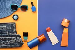 Summer concept. Relax on the beach, sunblock and sunglasses. For background Stock Images