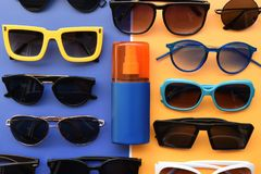 Summer concept. Relax on the beach, sunblock and sunglasses. For background Royalty Free Stock Photography