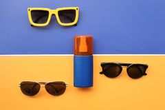 Summer concept. Relax on the beach, sunblock and sunglasses. For background Stock Photos