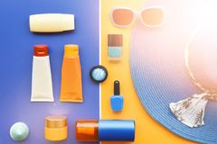 Summer concept. Relax on the beach, sunblock and sunglasses. For background Royalty Free Stock Image