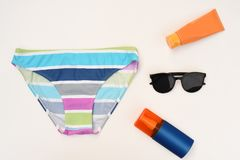 Summer concept. Relax on the beach, sunblock and sunglasses. On white background Stock Photo