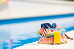 Summer concept-straw bag, tasty orange juice near Royalty Free Stock Photography