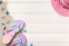 Summer concept. White Wooden background with beach items. Copy space royalty free stock photos