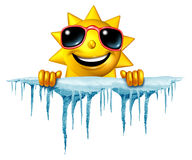 Summer Cool Down. Concept and cooling off idea as a sun character icon holding on to a chunk of snow and ice with icicles as a symbol for managing hot weather Royalty Free Stock Image