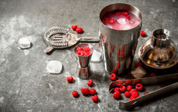 Summer cooling cocktail of wild raspberries with ice. On the stone table Royalty Free Stock Photo