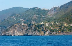 Summer Corniglia view from excursion ship, Cinque Terre, Italy. Beautiful summer Corniglia view from excursion ship. This is a famous villages of Cinque Terre Stock Photography