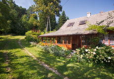 Summer cottage. Beautiful summer cottage with flower in the garden Stock Photography