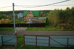 Summer cottage village in the evening in Russia. View from the second floorn Stock Photos