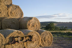 Summer countryside landscape of stack of hay bales against rural Stock Photo