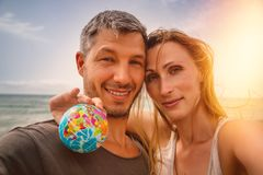 Summer couple on beach. World traveling couple in summertie royalty free stock image