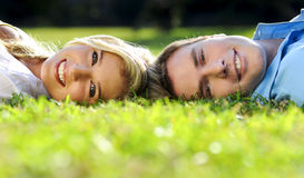 Summer couple in the park Stock Photos