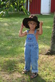 Summer cowboy. My 3 year old son Tyler wearing his big brothers cowboy hat Stock Images