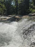Summer Creek - Little Waterfall Close-Up. Cool water flowing from a beautiful creek Stock Photo