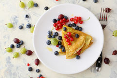 Summer crepe on white plate Stock Photography