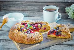 Summer crostata or galette pie with fresh garden berries. Over rusty wooden background. French cuisine - Breton galette. Sweet open pie royalty free stock photography