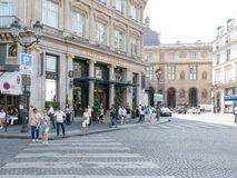 Summer crowd walks in front of Hotel du Louvre, Paris Royalty Free Stock Photo
