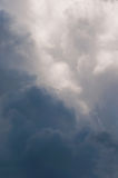 Summer cumulus storm clouds and the dark blue sky. Royalty Free Stock Photography