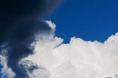 Summer cumulus storm clouds and the dark blue sky. Stock Photography