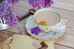 Summer cup of tea with lilac Royalty Free Stock Photo