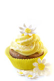 Summer cupcake. Made with blueberry cake and lemon frosting decorated with Daisies made of sugar Royalty Free Stock Photo