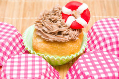 Summer cupcake with lifeguard float Stock Photo