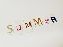 Summer - Cutout Words Collage Of Mixed Magazine Letters with White Background. Caption composed with letters torn from magazines with White Background Stock Photography