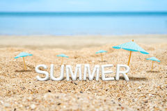 Summer (3D Rendering text) white word with beach umbrella on san Stock Photography