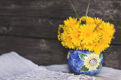 Summer dandelion flower arrangement in vase Stock Images