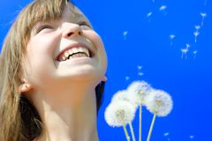 Summer day. Summer. Happy girl blowing dandelion royalty free stock photo