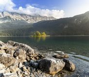 Summer day in an alpine landscape. The picture represents one of the islands on Lake Eibsee in southern Germany stock images
