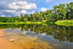 Summer day on the banks of a beautiful river Stock Image