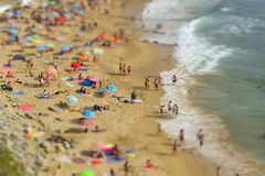 Summer day at the beach with coastal bluffs and the Atlantic Ocean. Beachgoers enjoy a beautiful summer day at the beach with coastal bluffs and the Atlantic stock images