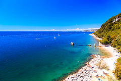 Summer day at the beach in the gulf of Trieste Royalty Free Stock Images