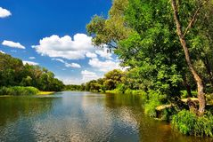 Summer day on the beautiful river. Under blue cloudy sky Stock Image